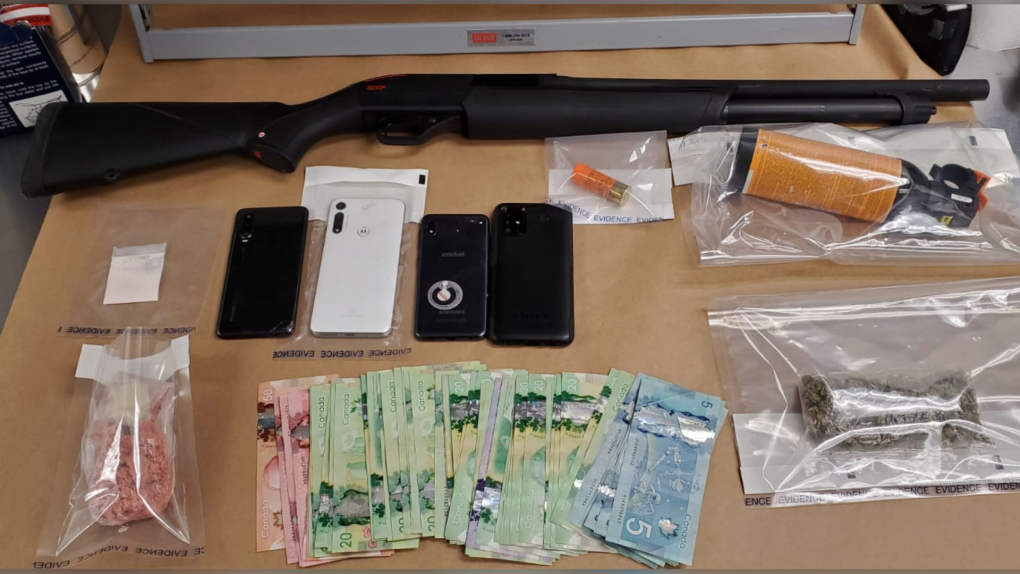 Seized drugs and shotgun