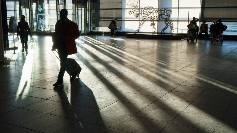 A passenger walks the halls at Montreal Trudeau Airport during the COVID-19 pandemic in Montreal, Wednesday, Dec. 23, 2020. THE CANADIAN PRESS/Paul Chiasson