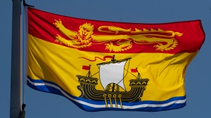 New Brunswick's provincial flag flies on a flag pole in Ottawa, Monday July 6, 2020. THE CANADIAN PRESS/Adrian Wyld