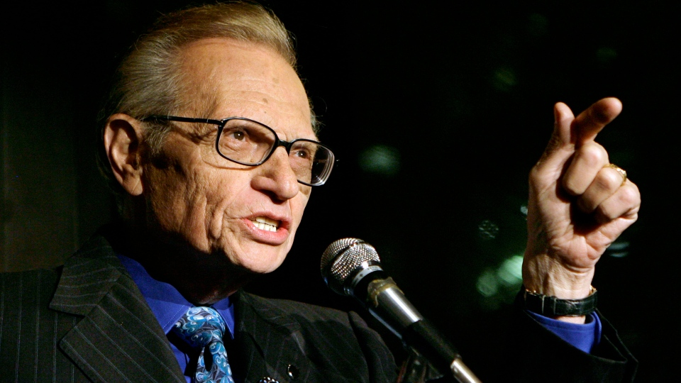 Larry King speaks to guests
