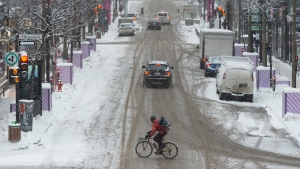 A few people make their way through downtown as COVID-19 restrictions continue, Thursday, January 21, 2021 in Montreal. THE CANADIAN PRESS/Ryan Remiorz