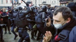 Police clash with demonstraters during a protest against the jailing of opposition leader Alexei Navalny in People gather in St.Petersburg, Russia, Saturday, Jan. 23, 2021. Russian police are arresting protesters demanding the release of top Russian opposition leader Alexei Navalny at demonstrations in the country's east and larger unsanctioned rallies are expected later Saturday in Moscow and other major cities. (AP Photo/Dmitri Lovetsky)