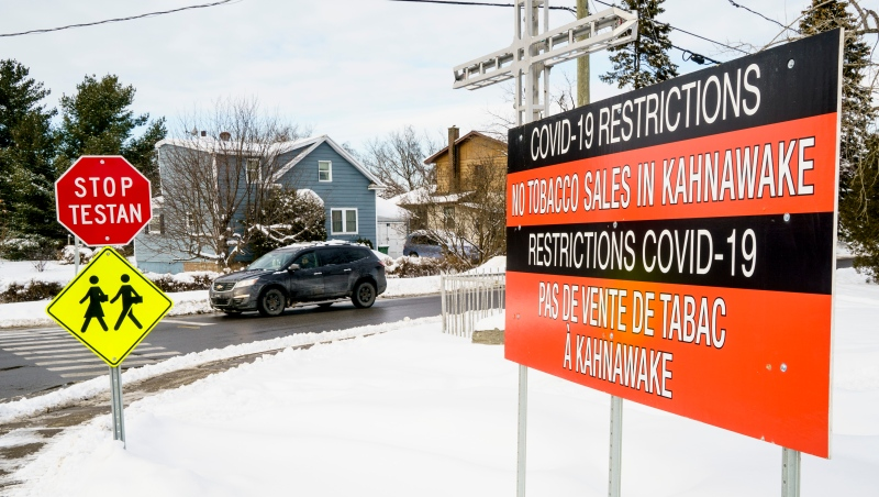 A COVID-19 sign is seen in Kahnawake, Que. on Friday, January 22, 2021. THE CANADIAN PRESS/Paul Chiasson