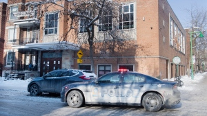 A police cruiser is shown outside a synagogue in an Orthodox Jewish neighbourhood in Montreal, Saturday, January 23, 2021, as the COVID-19 pandemic continues in Canada and around the world. Police were called to the synagogue with reports of an illegal gathering. THE CANADIAN PRESS/Graham Hughes