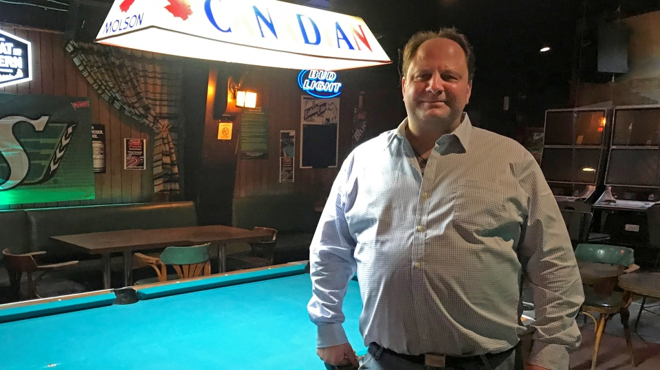 Kevin Citynski, the owner of the Jolly Roger Beer Store & Tavern stands next to a pool table inside of the iconic Regina bar. (Cally Stephanow/CTV News)