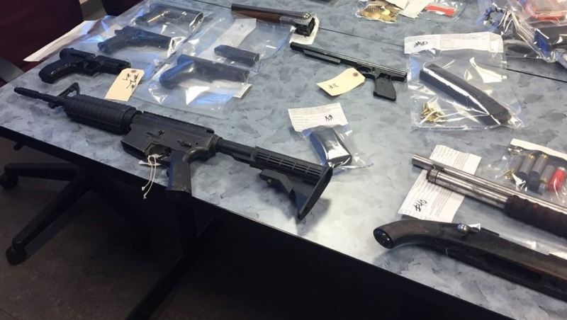 Didsbury RCMP seized a number of weapons, including firearms and knives, from a home at the centre of a drug bust. (Supplied/RCMP)