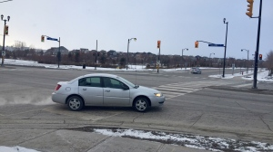 Police say a woman was hit by two different drivers who took off at this intersection in Bradford, Ont. shown on Saturday, January 23, 2021 (Steve Mansbridge/CTV News)
