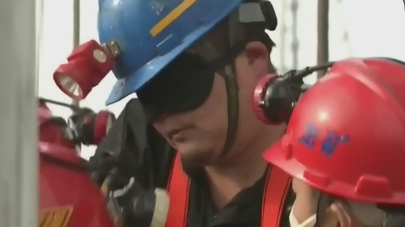 Trapped workers rescued from Chinese gold mine
