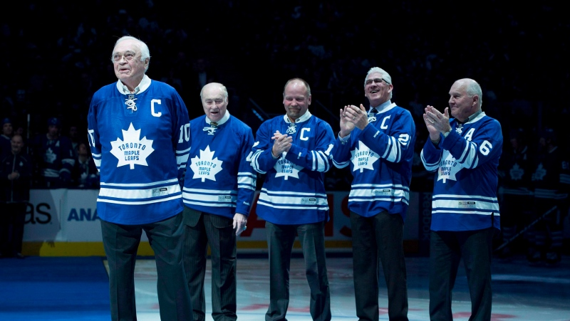 Toronto Maple Leafs alumni applaud fellow alumni George Armstrong, left, during a pre-game ceremony before the Toronto Maple Leafs and Winnipeg Jets NHL game in Toronto on Saturday, February 21, 2015. THE CANADIAN PRESS/Darren Calabrese