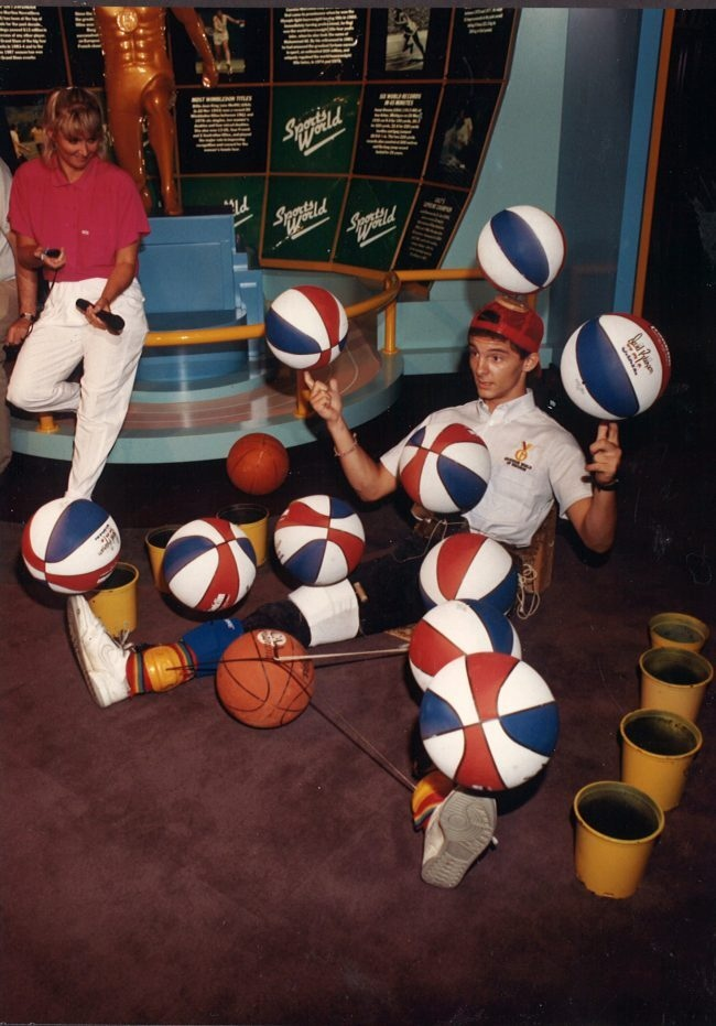 Man balancing basketballs