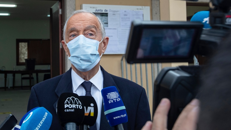 Portuguese President, and candidate for reelection, Marcelo Rebelo de Sousa speaks to journalists after voting at a polling station in Celorico de Basto, northern Portugal, Sunday, Jan. 24, 2021. (AP Photo/Luis Vieira)