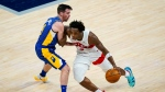 Toronto Raptors forward OG Anunoby (3) drives on Indiana Pacers guard T.J. McConnell (9) during the second half of an NBA basketball game in Indianapolis, Sunday, Jan. 24, 2021. (AP Photo/Michael Conroy)