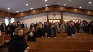 Screenshot from Pastor Henry Hildebrandt's YouTube page, shows maskless parishioners inside church, Sunday, Jan. 24 2021 (Jordyn Read/CTV News)