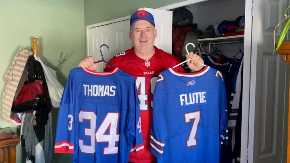 Brad Payment of Ottawa trying to decide which Bills jersey to wear for Sunday's AFC Championship Game. (Dave Charbonneau/CTV News Ottawa)