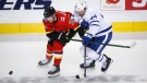 Toronto Maple Leafs' Morgan Rielly, right, tries to get past Calgary Flames' Joakim Nordstrom during third period NHL hockey action in Calgary, Sunday, Jan. 24, 2021. THE CANADIAN PRESS/Jeff McIntosh