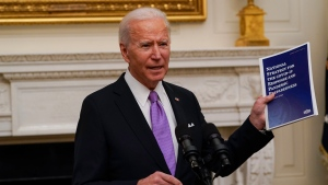 In this Jan. 21, 2021, file photo U.S. President Joe Biden holds a booklet as he speaks about the coronavirus in the State Dinning Room of the White House in Washington. (AP Photo/Alex Brandon, File)