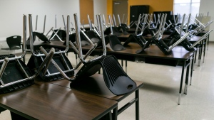 An empty classroom can be seen at Miami Community Charter School in Flagler City, Fla. during the first day of class on Monday, Aug. 31, 2020. Miami Community Charter is one of the few schools accommodating students who do not have Internet access at home or whose parents cannot stay home with them for remote learning. (Matias J. Ocner/Miami Herald via AP)
