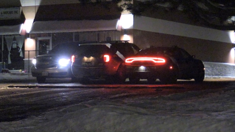 Police at the scene of a robbery near Little Avenue and Bayview Drive in Barrie, Ont. on Sunday, January 24, 2021 (Don Wright/CTV News)