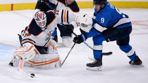 Edmonton Oilers goaltender Mikko Koskinen (19) makes a save on Winnipeg Jets' Andrew Copp (9) during first period NHL action in Winnipeg on Sunday Jan. 24, 2021. THE CANADIAN PRESS/Fred Greenslade