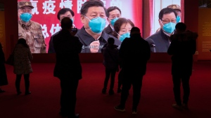 Residents attend an exhibition on the city's fight against the coronavirus in Wuhan in central China's Hubei province on Saturday, Jan. 23, 2021. (AP Photo/Ng Han Guan)