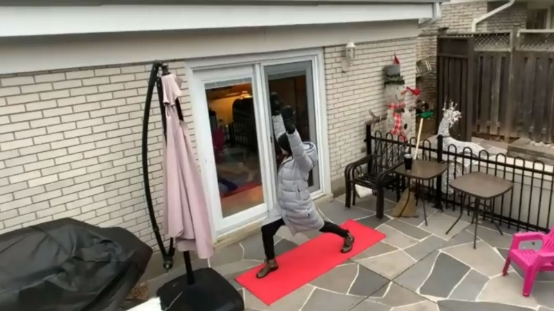While same may find it difficult to be physically active without access to a gym or trainer, a Toronto yoga instructor is showing clarity and vision by using windows to work out.