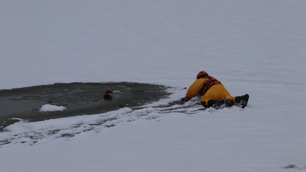 Teen falls through ice