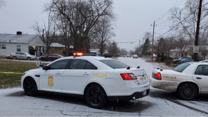 Indianapolis Metropolitan Police Department investigate the shooting deaths of five people, including a pregnant woman, on Jan. 24, 2021.  (Justin L. Mack / The Indianapolis Star via AP)