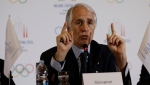 In this April 6, 2019 file photo, President of the Italian National Olympic Committee, CONI, Giovanni Malago' gestures as he talks during a winter Olympics Milan Cortina bid IOC Evaluation Commission final news conference, in Milan, Italy. The International Olympic Committee is slated in January 2021 to consider imposing a humiliating probation on Italy's team for the Tokyo Games due to a two-year domestic dispute that it says amounts to government interference. (AP Photo/Luca Bruno, file)