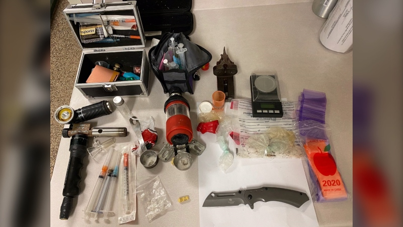Police say they seized what they believe to be methamphetamine, along with drug paraphernalia and a knife. (Photo submitted by Fredericton Police)