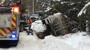 Crews work to pull a tanker truck out of a ditch on Fox Meade Road in Oro-Medonte on Monday, January 25, 2021 (Jim Holmes/CTV News)