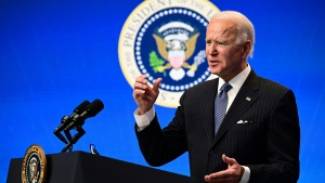 U.S. President Joe Biden delivers remarks before signing an Executive Order in the South Court Auditorium at the White House on January 25, 2021 in Washington, DC. (Jim Watson/AFP/Getty Images)