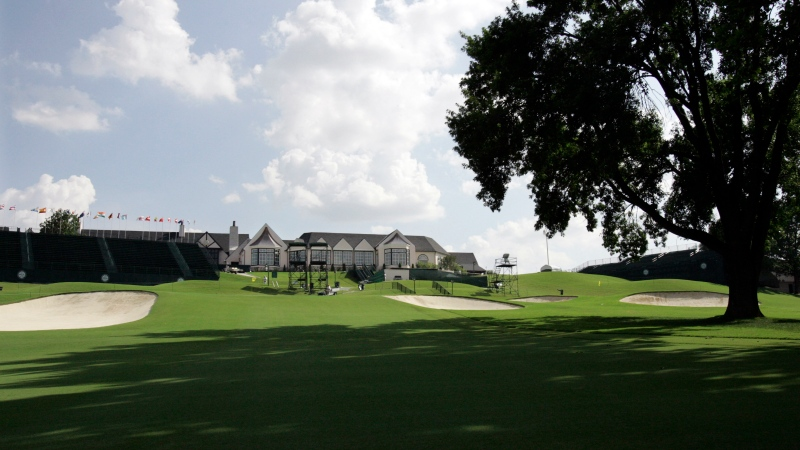In this Aug. 5, 2007, file photo, the 18th fairway with the Southern Hills Country Club clubhouse visible is viewed at the 89th PGA Golf Championship in Tulsa, Okla. (AP Photo/Rob Carr, File)
