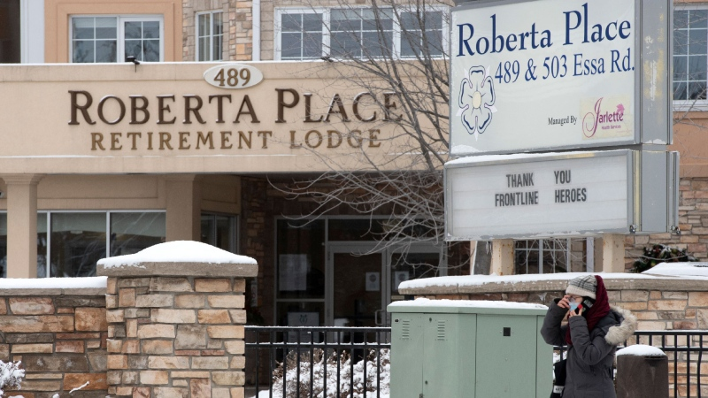 A woman arrives at the Roberta Place Long Term Care home in Barrie, Ont. on Monday, January 18, 2021. The home has seen an outbreak of COVID-19 among staff and residents. THE CANADIAN PRESS/Frank Gunn