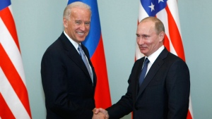 In this March 10, 2011, file photo, then-Vice President Joe Biden, left, shakes hands with Russian Prime Minister Vladimir Putin in Moscow, Russia. (AP Photo/Alexander Zemlianichenko, File)