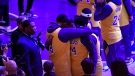 LeBron James #23 and Anthony Davis #3 of the Los Angeles Lakers hug during Los Angeles Lakers pregame ceremony to honor Kobe Bryant before the game against the Portland Trail Blazers at Staples Center on January 31, 2020 in Los Angeles, California. (Kevork Djansezian/Getty Images North America/Getty Images)
