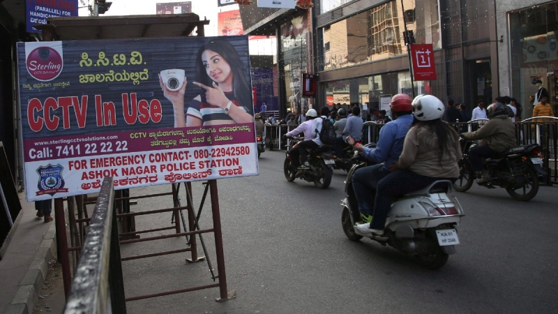 A banner displayed by Indian police informing people that the area is under surveillance of closed-circuit television cameras in Bangalore, India, on Dec. 31, 2017. (Aijaz Rahi / AP)