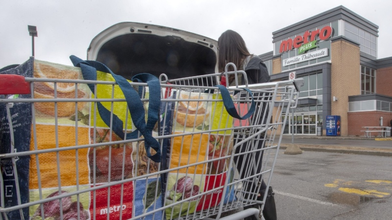 Loading groceries at a Metro store in Ste-Therese, Que., on April 15, 2019. (Ryan Remiorz / THE CANADIAN PRESS)