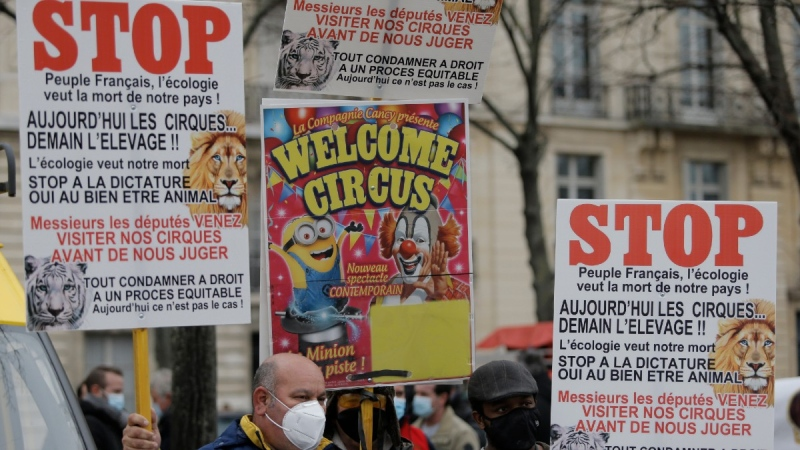 Circus workers holds posters during a protest near the National Assembly, on Jan.26, 2021. (Lewis Joly / AP)