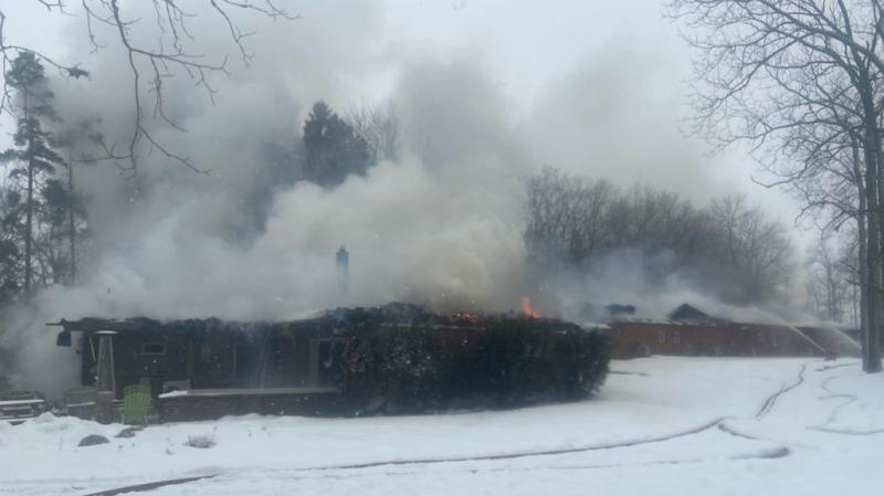 A motel near Stratford seen smoking as crews battle a fire. (@OPP_WR / Twitter)