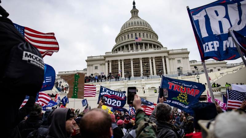 At least 150 people have been charged by the Justice Department in the Capitol riot. Pro-Trump supporters storm the Capitol following a rally with President Donald Trump on January 6 in Washington, DC. Samuel Corum/Getty Images via CNN