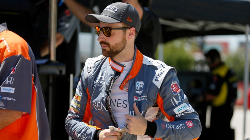 In this June 6, 2020, file photo, James Hinchcliffe prepares for practice at the IndyCar auto race at Texas Motor Speedway in Fort Worth, Texas. Hinchcliffe will return to Andretti Autosport for the final three races of the season to fill the seat left vacant when Zach Veach stepped out of the car earlier this week, Andretti Autosport announced Friday, Sept. 25, 2020. (AP Photo/Tony Gutierrez, File)