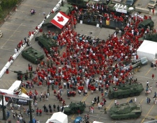 Hundreds gather while wearing red to show support for the troops in Afghanistan at a Toronto rally on Aug. 24, 2007.
