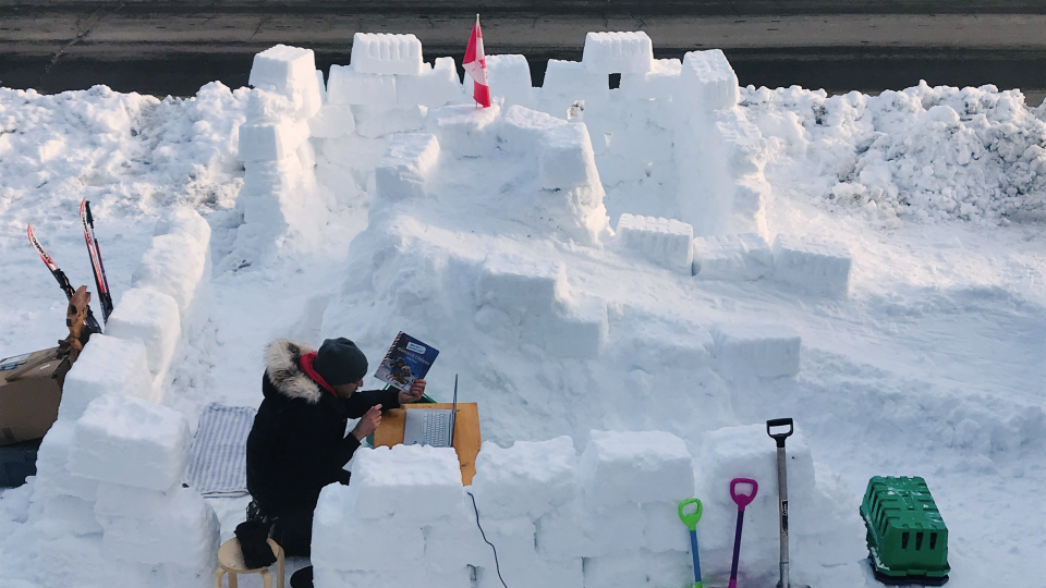 Patrick Revie teaches a virtual class inside a snow fort on his front lawn. (Photo courtesy of Karen Lambert)