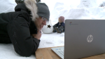 Patrick Revie teaches a virtual class with a snow fort on his front lawn as the backdrop. (Jim O'Grady / CTV News Ottawa)