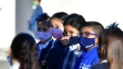 Students wear face masks at a school in the U.S., where many classrooms remain shuttered due to the pandemic. (AFP)