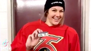 Lindsay Eastwood holding the puck from the goal she scored, the first in Toronto Six franchise history. (Lindsay Eastwood / TikTok)