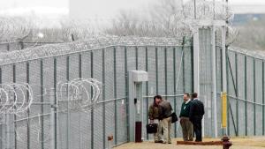 In this March 22, 2005, file photo, men wait outside the Cimarron Correctional Facility in Cushing, Okla. (David McDaniel/The Oklahoman via AP, File)