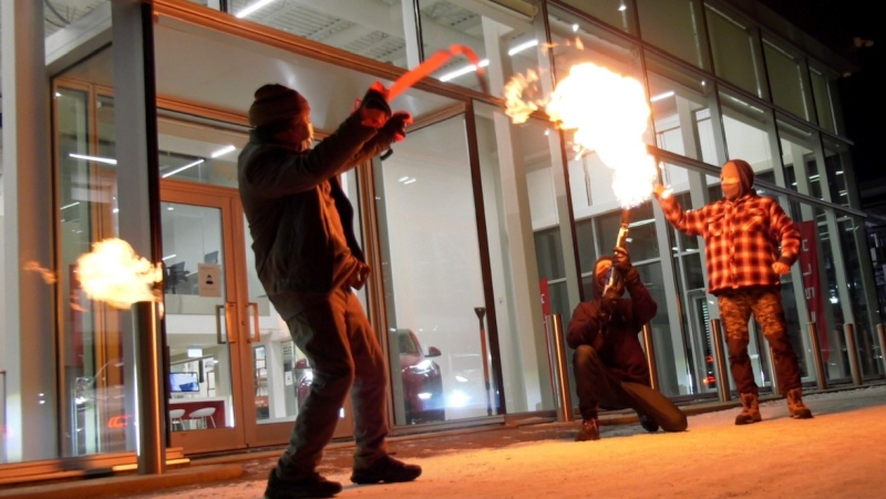 Tyler Krause uses a flamethrower to cut the ceremonial ribbon on Saskatchewan's first Tesla Store on Jan. 26. Francois Biber/CTV Saskatoon