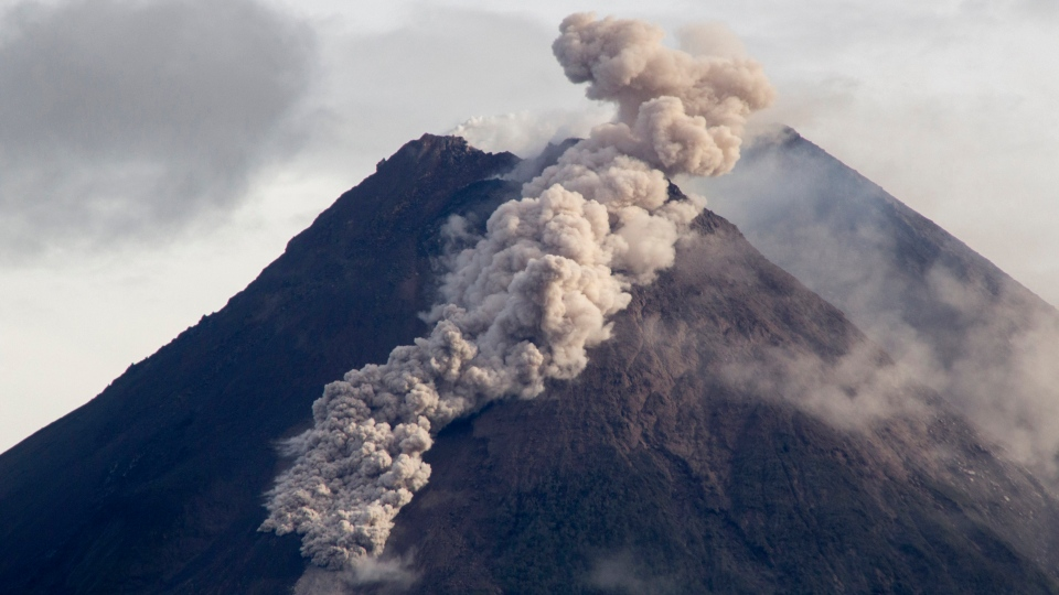 Hot cloud of volcanic materials run down the slope of Mount Merapi during an eruption in Sleman, Wednesday, Jan. 27, 2021. (AP Photo/Slamet Riyadi)