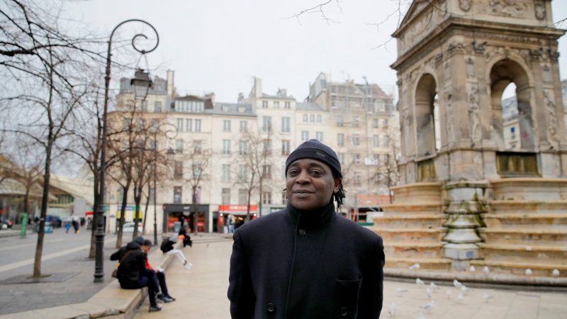 Omer Mas Capitolin, the head of Community House for Supportive Development, poses for a photo, in Paris, Tuesday Jan. 26, 2021. (AP Photo/Christophe Ena)